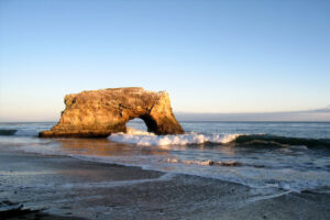 Rock archway at Natural Bridges State Beach in Santa Cruz, California